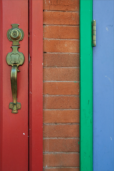 Detail of two colorful doors side-by-side.