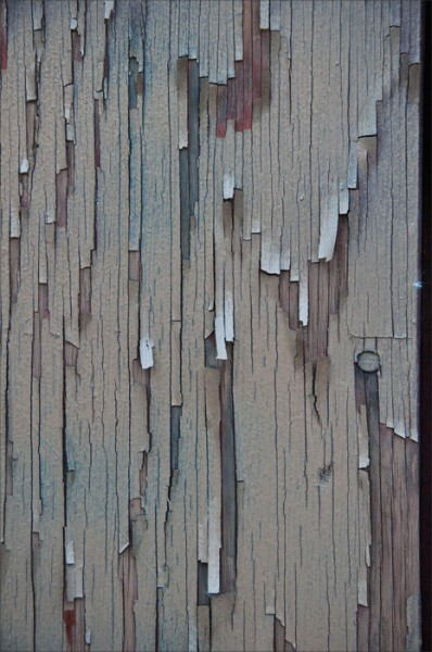 Peeling paint in muted hues.