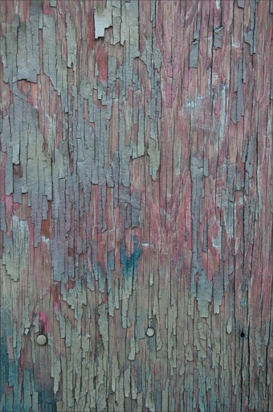 Peeling paint in pastel hues.